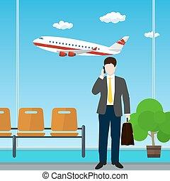 Ein Mann mit einem Koffer am Flughafen.