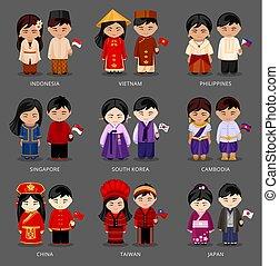 Ein paar asianische Paare in verschiedenen nationalen Kostümen.