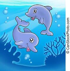 Ein Paar süßer Delfine spielen