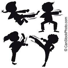 Ein Paar Silhouette Karate-Kinder.