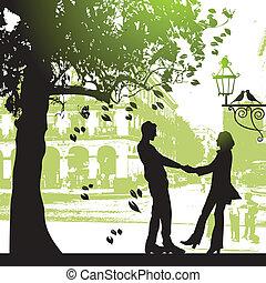 Ein Paar unter dem Baum im Stadtpark