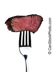 Ein Stück von einem gegrillten Steak auf einer Gabel