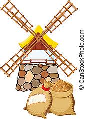 Eine alte Windmühle und Säcke mit Weizen