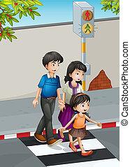 Eine Familie, die die Straße überquert