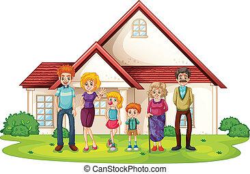 Eine Familie vor ihrem großen Haus.