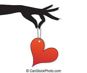 Eine Frau hat ein rotes Herz