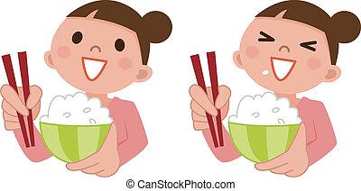 Eine Frau isst köstlichen Reis