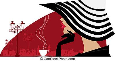 Eine Frau mit einem großen Hut im Café