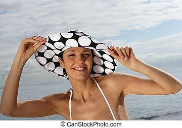 Eine Frau mit Hut