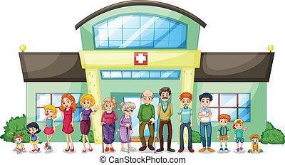 Eine große Familie vor dem Krankenhaus.