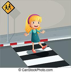 Eine junge Dame überquert die Fußgängerstraße