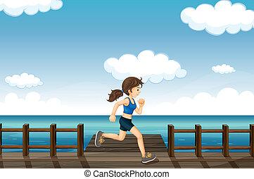 Eine junge Frau joggt