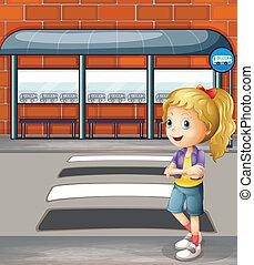Eine lächelnde junge Frau steht neben der Fußgängerstraße