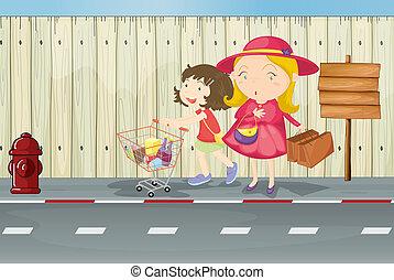 Eine Mutter und ein Kind neben dem leeren Schild