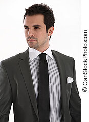 Eleganter gutaussehender Mann im Anzug