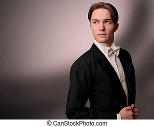 Eleganter junger Mann im Anzug