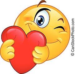 Emoticon umarmt das Herz.