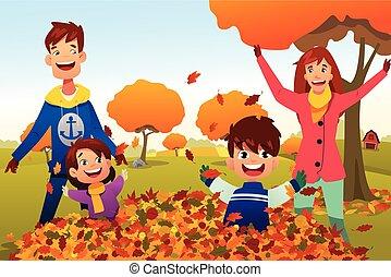 Familie feiert Herbstsaison im Freien.