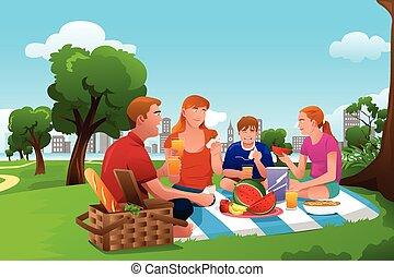 Familie macht ein Picknick im Park.