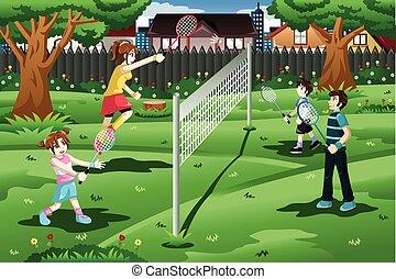 Familie spielt Badminton im Garten.