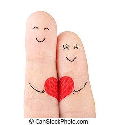 Familienkonzept - ein Mann und eine Frau halten das rote Herz fest, mit Fingern bemalt und auf weißem Hintergrund isoliert