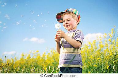 Farbiges Bild von einem Kind, das Löwenzahn spielt