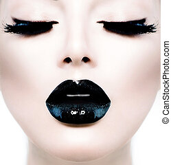 Fashion beauty model girl with black make up and long lushes.