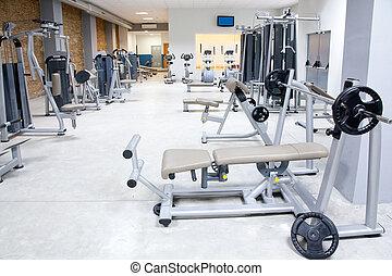 Fitness-Club-Studio mit Sportgeräten innen.