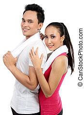 Fitness, lächelndes junges Paar, Mann und Frau