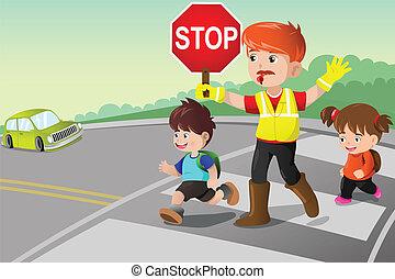 Flagger und Kinder überqueren die Straße.