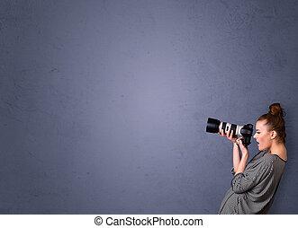 Fotografen schießen Bilder mit Kopierraum.