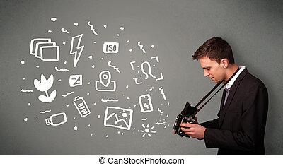 Fotografenjunge, der weiße Fotografie Icons und Symbole erfasst.