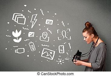 Fotografin, die weiße Foto-Ikonen und Symbole gefangen hält