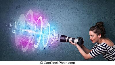 Fotografinnen machen Fotos mit starkem Lichtstrahl.