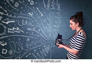 Fotografinnen schießen Bilder während energiegeladene Handlinien und Zeichnungen aus der Kamera kommen