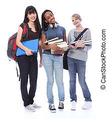 Fröhliche jugendliche, ethnische Schülerinnen in der Ausbildung
