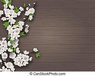 Frühlingsblütiger Kirschzweig auf altem Holzboden.