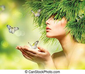 Frühlingsfrau. Sommermädchen mit Grashaar und grünem Make-up