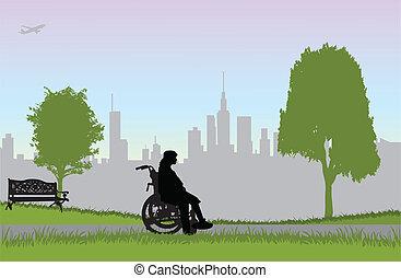 Frau im Rollstuhl - wandern im Park.