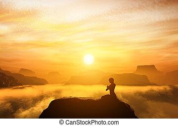 Frau meditiert in Sitz Yoga Position auf dem Gipfel eines Berges
