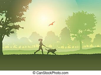Frauen joggen mit Hund auf dem Land.
