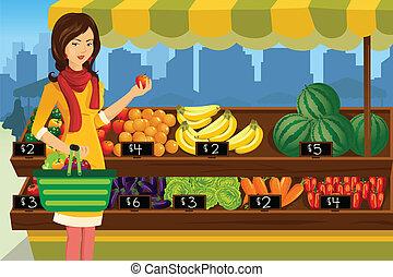 Frauen kaufen in einem Freiluft-Bauermarkt