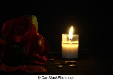 Frohen Valentinstag mit Blumenrose und Kerzen brennenden Fotoshooting.