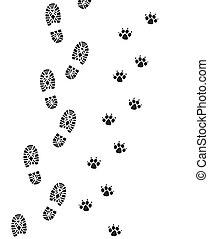 Fußabdrücke von Mann und Hund