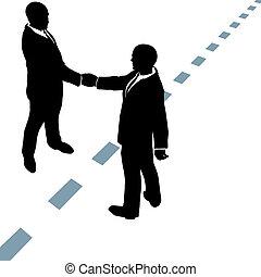Geschäftsleute schütteln sich die Hand über die Punkte