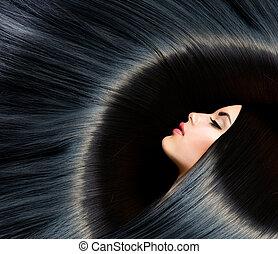 Gesunde, lange schwarze Haare. Schöne Brünette