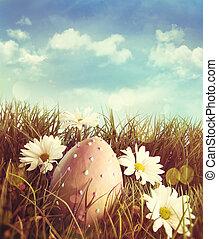 Große Ostereier im Gras mit Daisy.