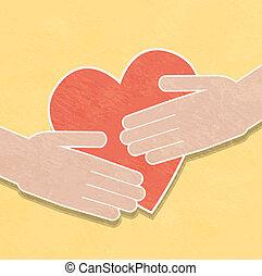 Hände halten das Herz. Charity