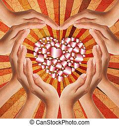 Hände machen Herzform.