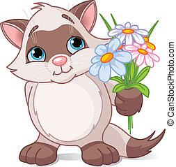 Hübsches Kätzchen mit Blumen.
